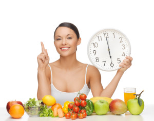 after six o'clock diet - happy woman with fruits and vegetables